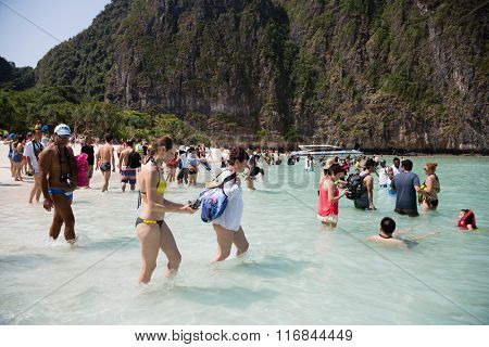 PHI PHI ISLANDS, THAILAND - CIRCA FEBRUARY, 2015: Tourists rest on the beach of Maya Bay on Phi Phi Leh island. It starred the famous movie The Beach with the actor Leonardo DiCaprio