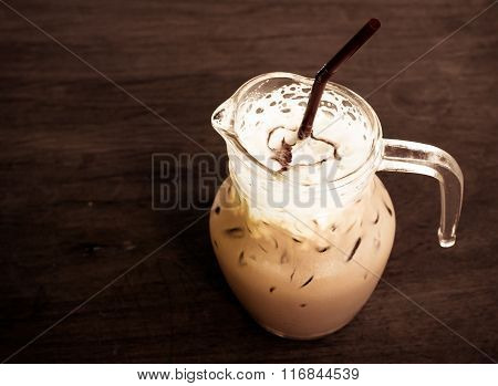 A Cup Of Iced Caramel Cappuccino Coffee In A Transparent Cup On Wooden Background. Vintage Tone Proc