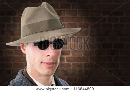 Gangster Or Fbi Agent With A Hat And Black Glasses