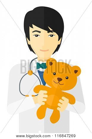 Pediatrician holding teddy bear.