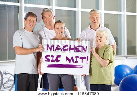 Group of senior people holding sign saying German slogan