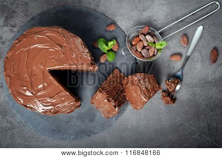 Chocolate pie with ingredients on table