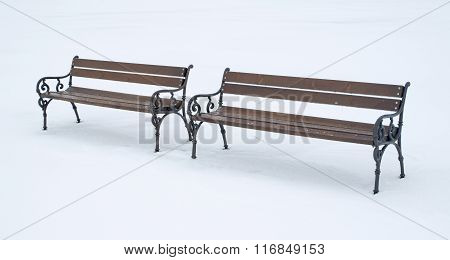 Two Wooden Benches In A Winter Day