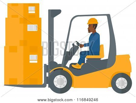 Worker moving load by forklift truck.