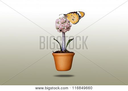 Artificial Flowers And Butterfly In Clay Pots
