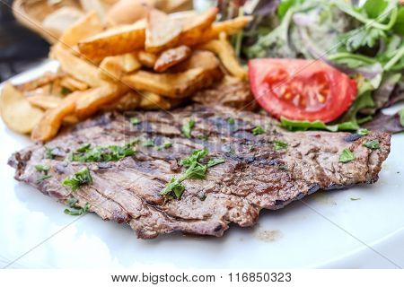 juicy steak beef meat with tomato and french fries