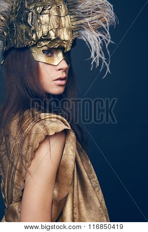 Woman in creative head wear with feathers