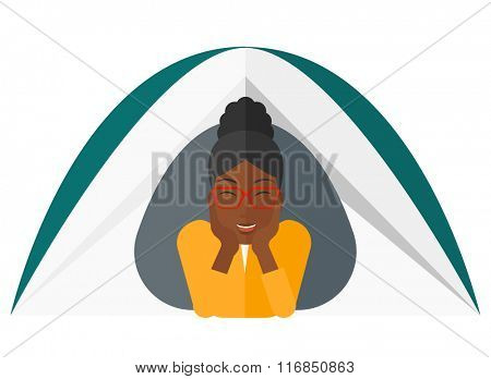Woman lying in tent.