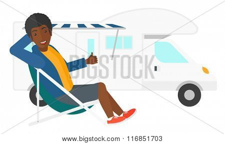 Man sitting in front of motorhome.