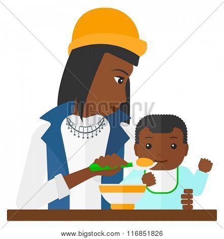 Woman feeding baby.