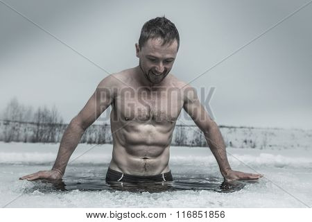 Man bathing in the ice hole