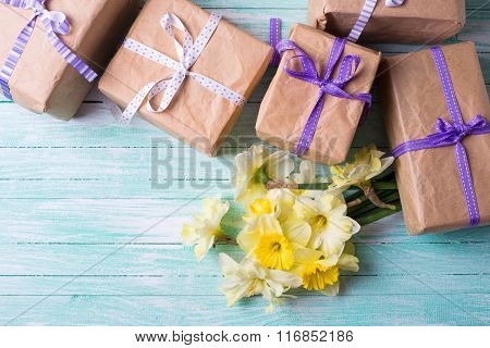 Yellow Daffodils  Flowers And Wrapped Gift Boxes On Turquoise  Wooden Background.