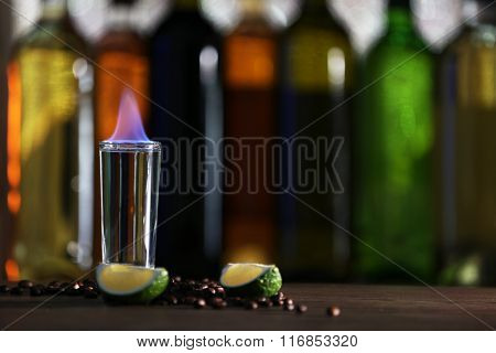 Burning cocktail on table in a bar