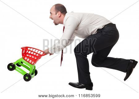 isolated man with toy shopping cart