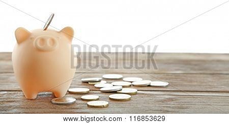 Piggy bank with coins isolated on white