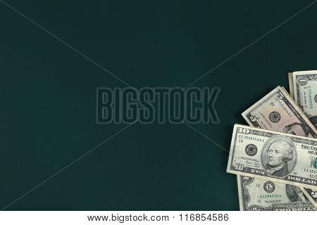 Dollar banknotes on dark background