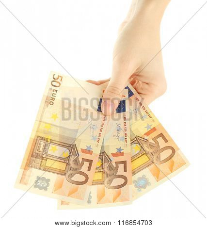 Fan of money in female hand isolated on white