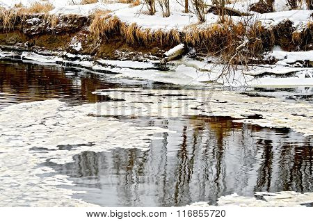 Ice in water and snow on the shore