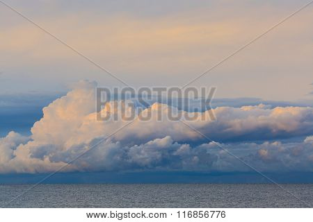 Low Dramatic Fluffy Clouds Over Sea Water