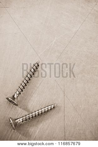 screws tool at metal background texture