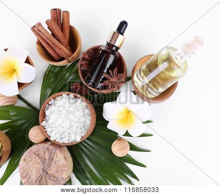 Beautiful spa setting on palm leaf, isolated on white