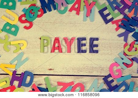 Payee Word Block Concept Photo On Plank Wood