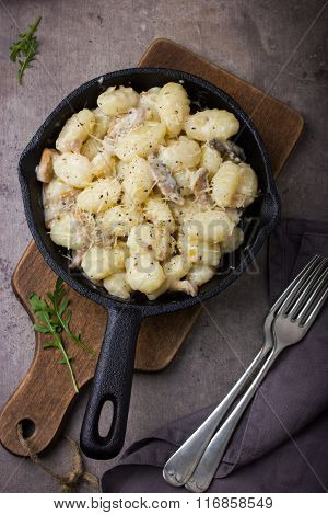 Italian Potato Gnocchi With Mushrooms Sauce And Cheese