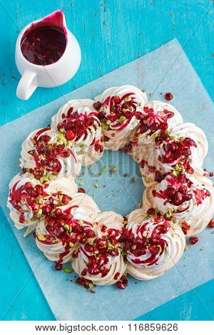 Meringues Pavlova Cake Wreath With Pomegranate, Cranberry And Pistachios