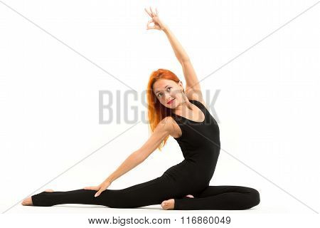 Sporty young woman doing yoga asana