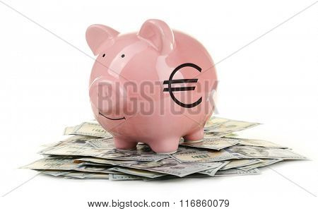 Piggy bank with dollars isolated on white
