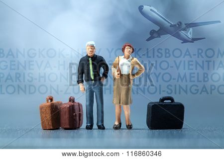 Miniature people - businessmen waiting in the airport lobby