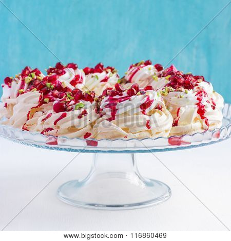 Pavlova Cake With Pomegranate, Cranberry And Pistachios