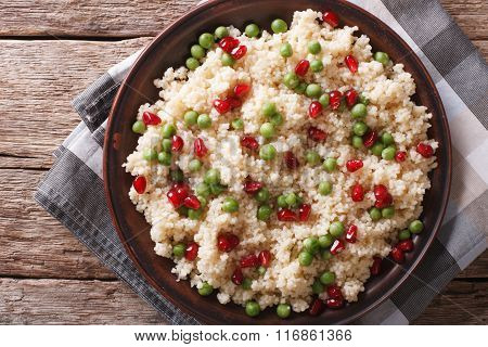 Couscous Salad With Peas And Pomegranate Closeup. Horizontal Top View