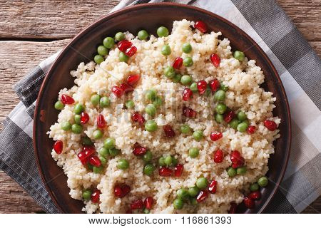 Couscous With Pomegranate Close-up. Horizontal Top View
