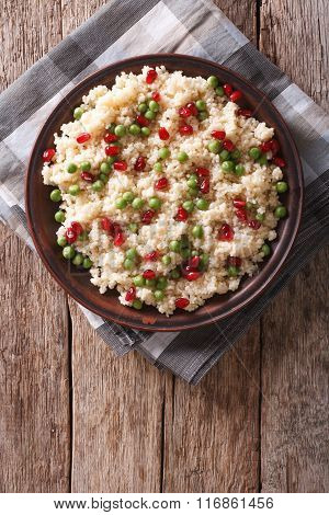 Couscous Salad With Green Peas And Pomegranate. Vertical Top View