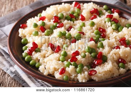 Couscous With Green Peas And Pomegranate Close-up. Horizontal