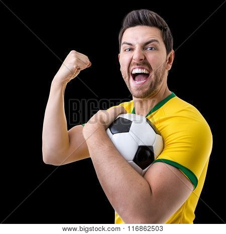 Brazilian male fan celebrating on black background