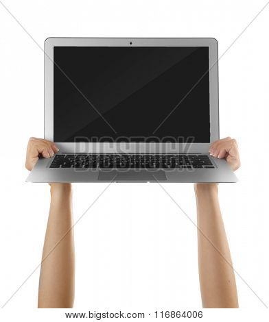 Modern laptop in hands isolated on white background