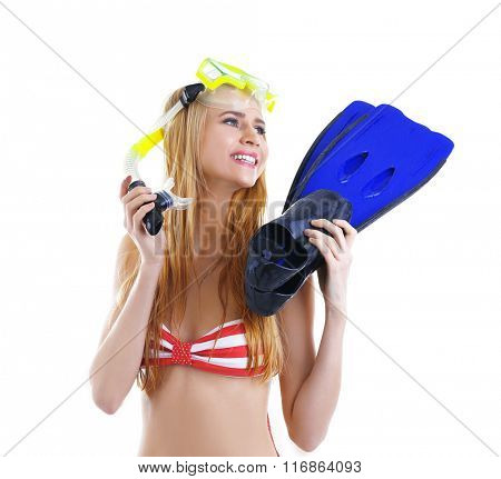 Young beautiful woman in swimsuit posing with diving mask and flippers, isolated on white
