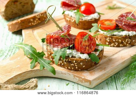 Sandwiches With Salami, Cherry Tomatoes And Arugula