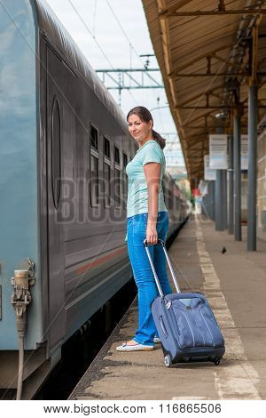 Traveler Young Girl At Station With A Suitcase