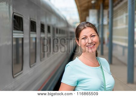 Portrait Of A Beautiful Woman In A Train Station Near The Train