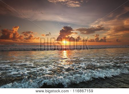 Beautiful view on sea under sunset sky on Bali