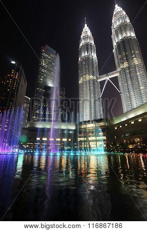 View on Petronas Twin Towers fountain in Kuala Lumpur at night