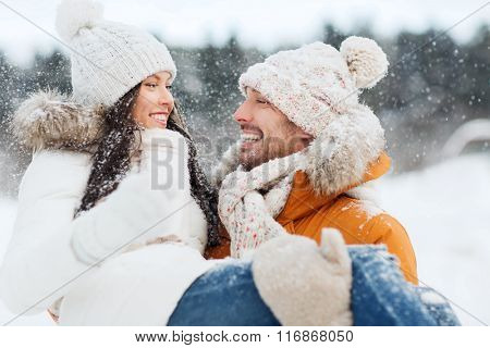 happy couple outdoors in winter