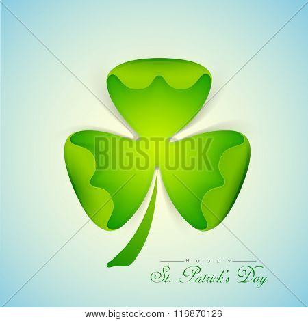 Creative glossy Shamrock Leaf on shiny blue background for Happy St. Patrick's Day celebration.
