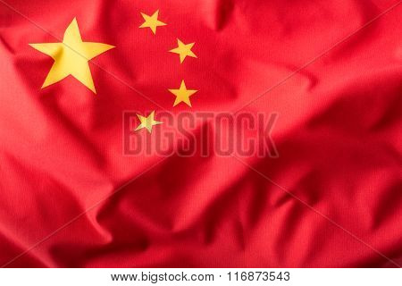 China flag. Peoples Republic of China flag blowing in the wind