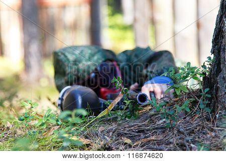 Sniper With Paintball Gun Disguised In Grass. Focus On Top Of Barrel.