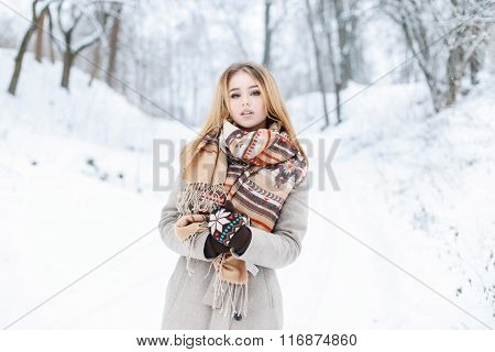 Beautiful Winter Portrait Of A Young Girl With A Scarf And Coat On The Background Of Snowy Park