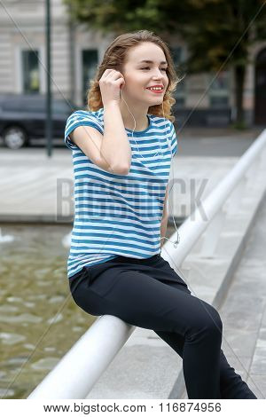 Student In A Striped T-shirt Listening To Music